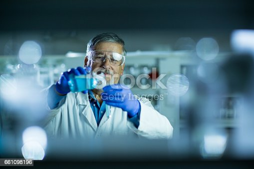 661098200istockphoto Senior male researcher carrying out scientific research in a lab 661098196