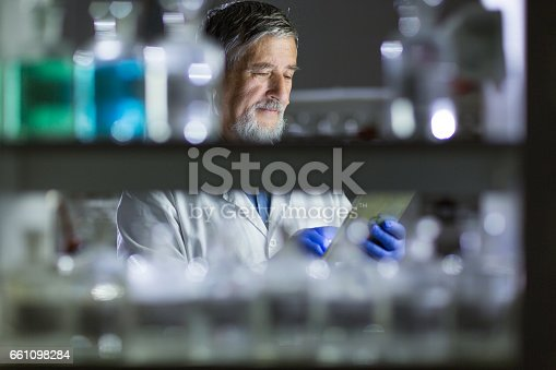 661098200istockphoto Senior male researcher carrying out scientific research in a lab 661098284
