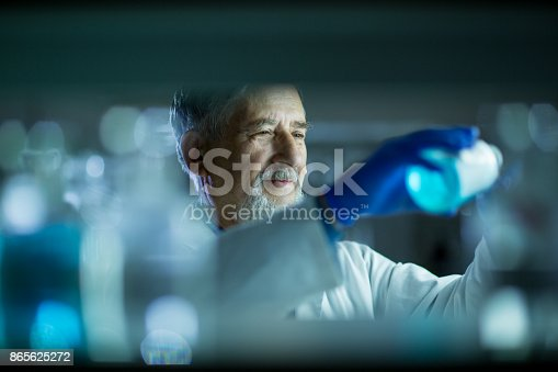 661098200istockphoto Senior male researcher carrying out scientific research in a lab 865625272