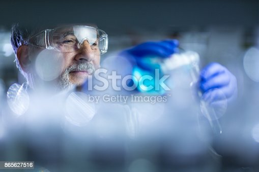 661098200istockphoto Senior male researcher carrying out scientific research in a lab 865627516