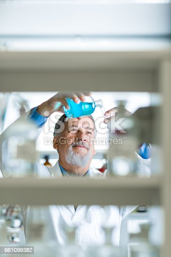 661098200istockphoto Senior male researcher  in a lab 661099382