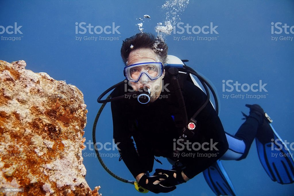 Senior Male Scuba Diver looking at camera with copy space stock photo