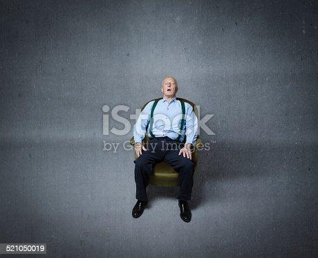 senior male sleeping on an old sofa