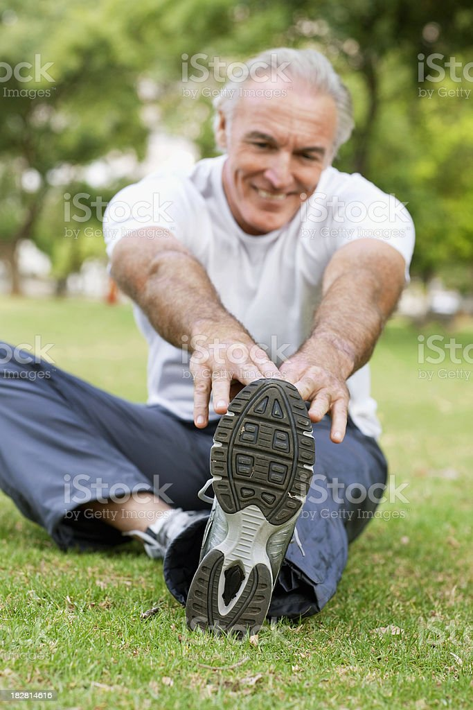 Senior Male Stretching in the Park royalty-free stock photo