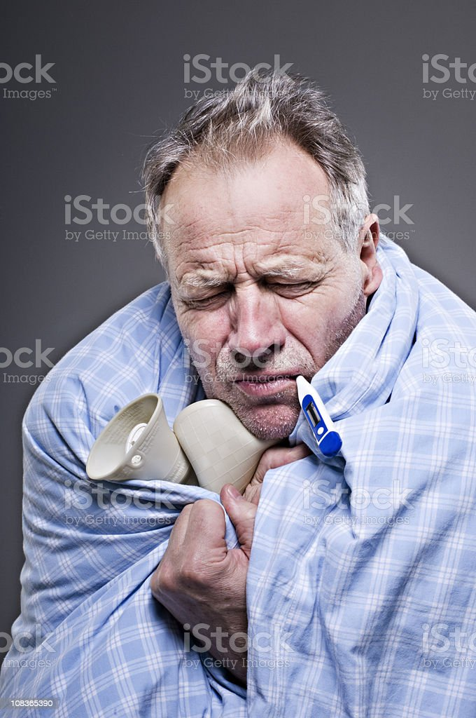 Senior Male Suffering With A Cold or Man Flu stock photo