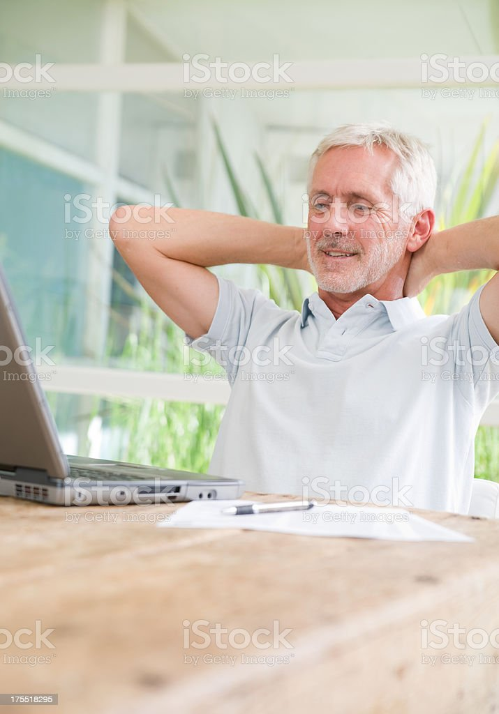 Senior male with laptop royalty-free stock photo