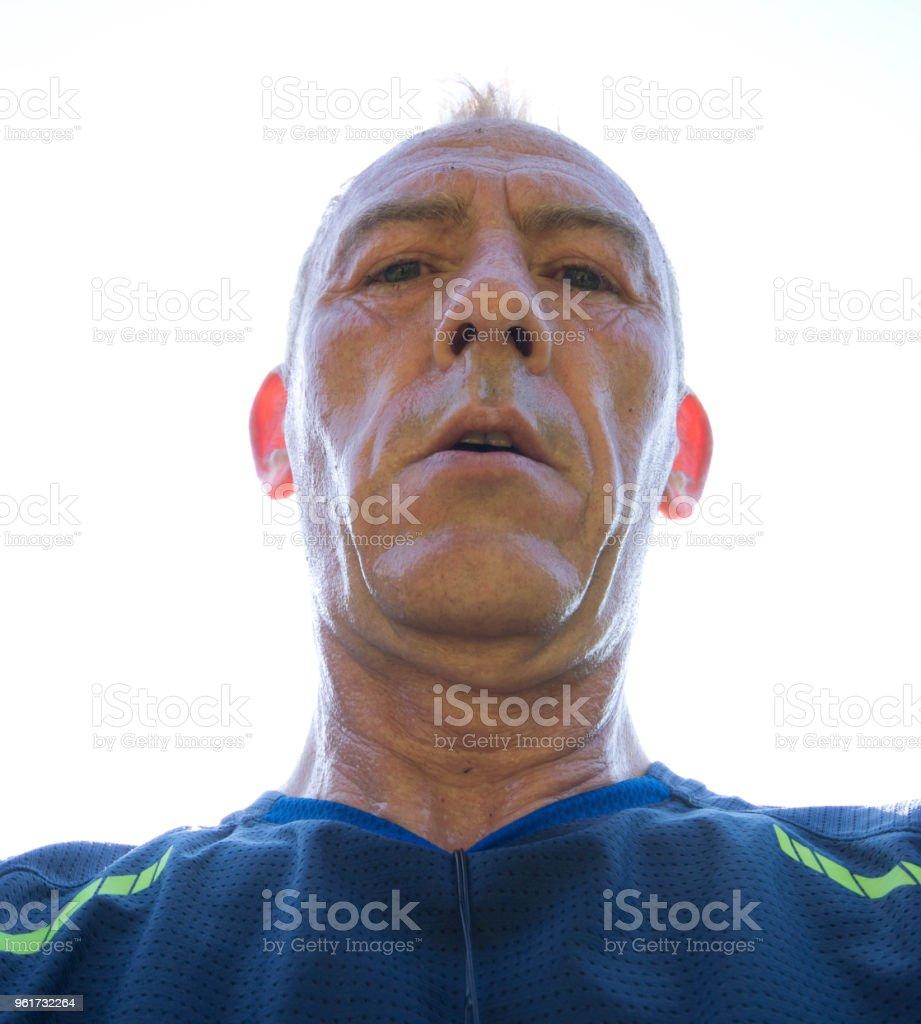 Senior man after a long run in the sun stock photo