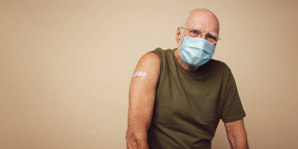 Senior man after receiving covid-19 vaccination stock photo