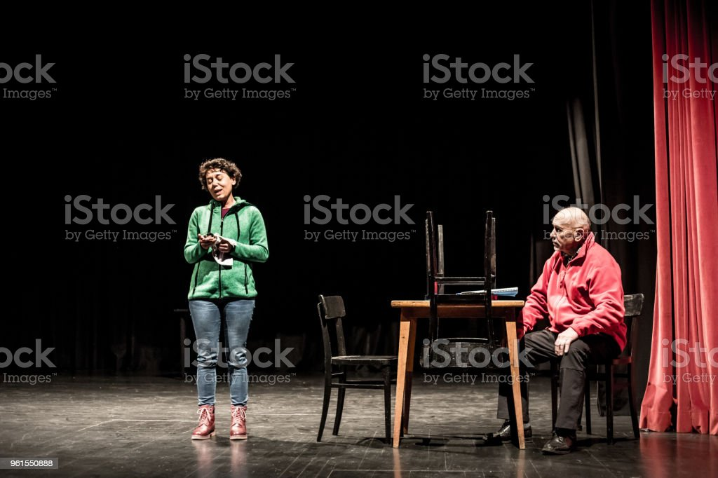 Senior Man and Adult Woman Acting on Stage.