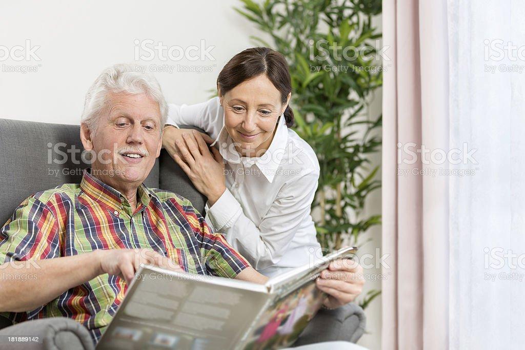 Senior man and caregiver royalty-free stock photo