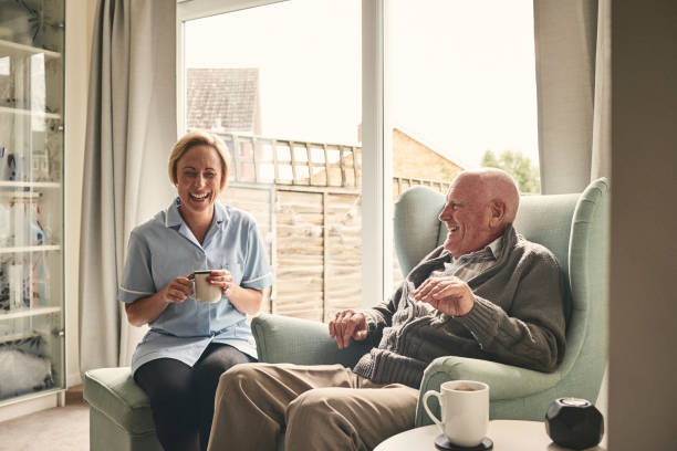 Senior man and female carer enjoying coffee at home picture id912073314?b=1&k=6&m=912073314&s=612x612&w=0&h=4ynalhfdpc5dygd65xhcwybfq7sqsxqgsptmiq088h0=