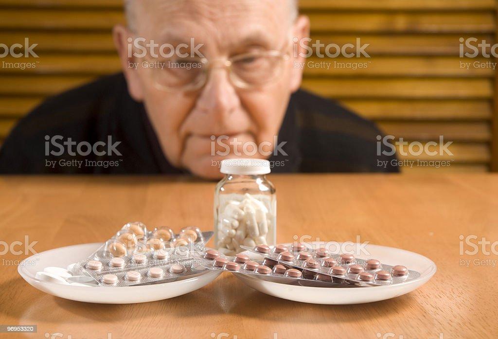 Senior man and his pills royalty-free stock photo