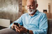Senior man using his phone
