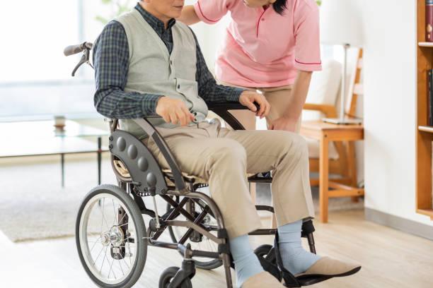 Senior man and home helper stock photo