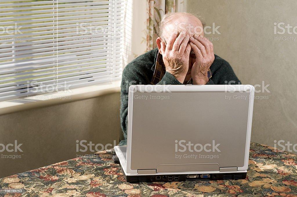 Senior man and laptop royalty-free stock photo