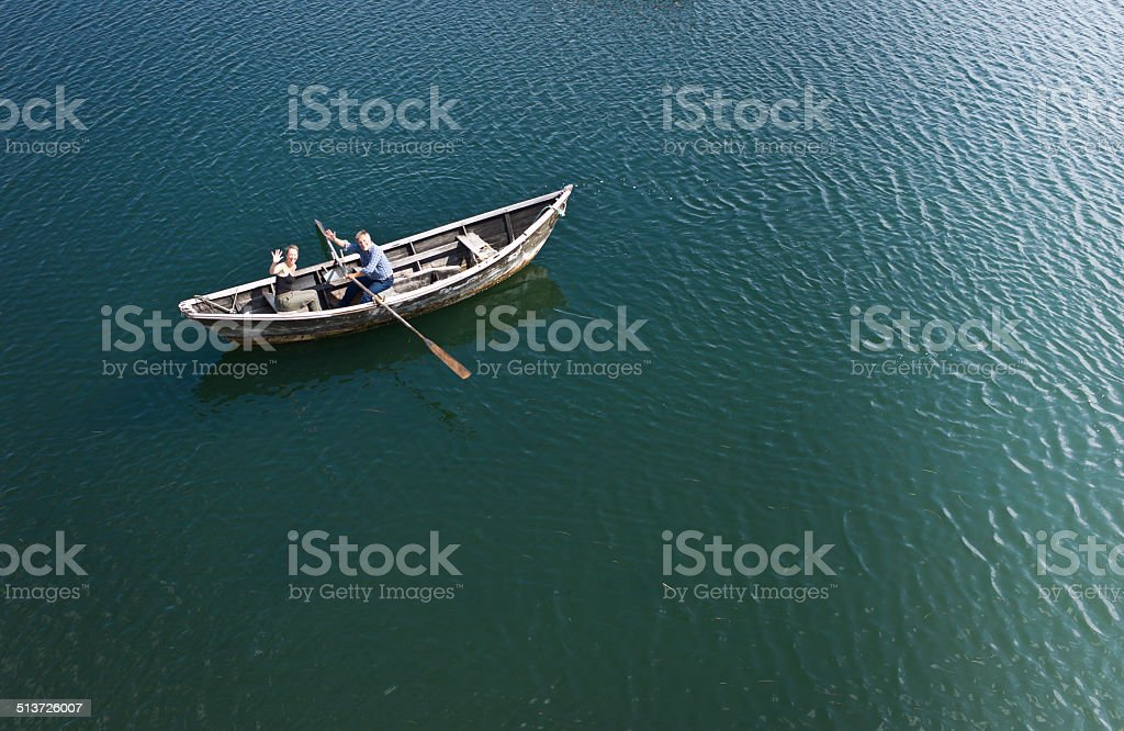 Senior Man and Mature Woman in a Dory Row boat. stock photo