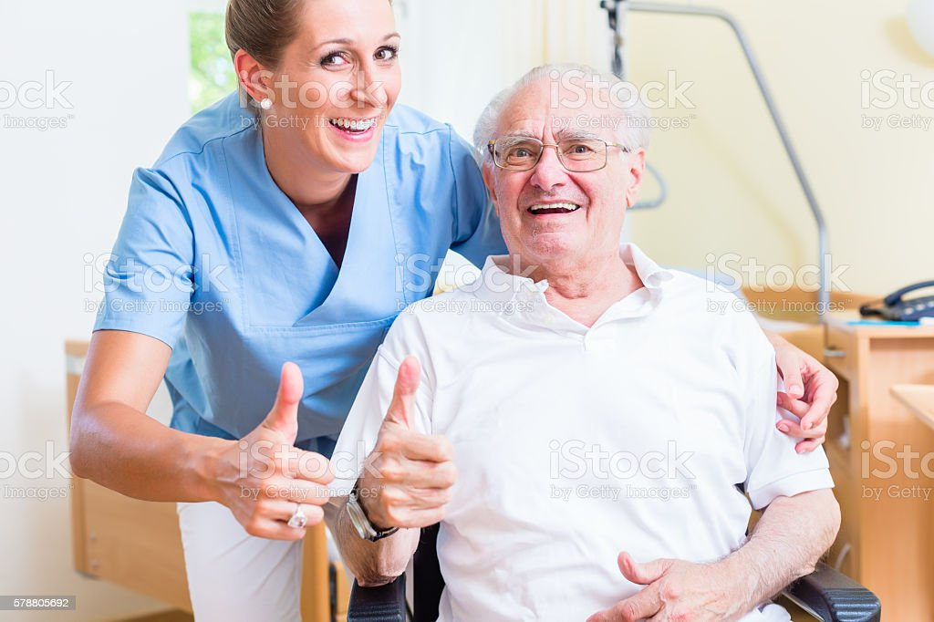 Senior Man And Nurse Recommending Nursing Home Stock Photo Download Image Now Istock