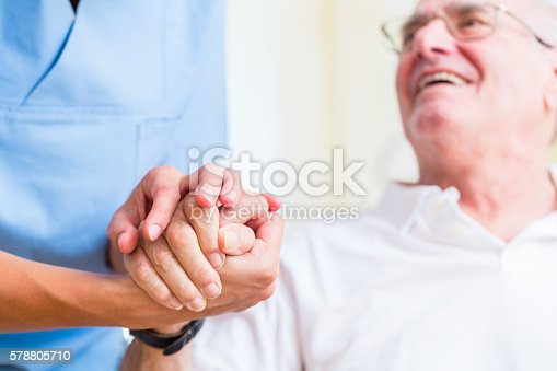 istock Senior man and old age nurse in nursing home 578805710