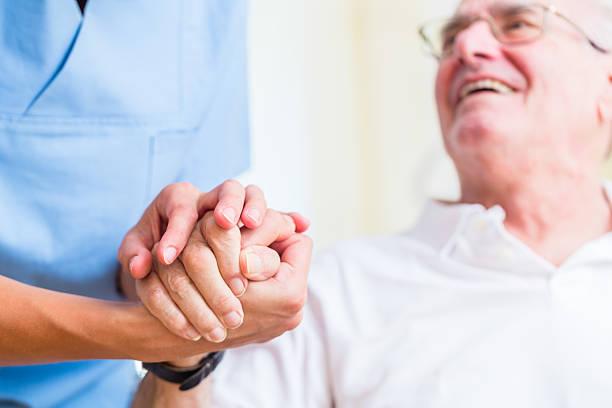 Senior man and old age nurse in nursing home picture id578805710?b=1&k=6&m=578805710&s=612x612&w=0&h=kh czgbeofnf2okkrnpje5ajmzkph3o trbhngdxuua=
