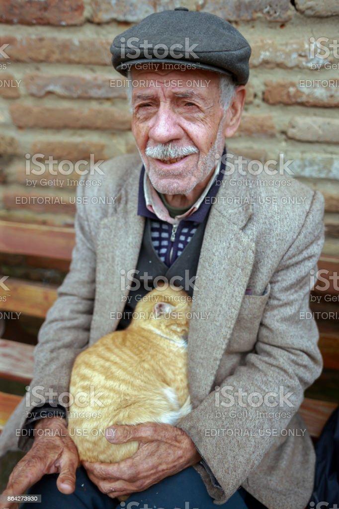 Senior Man and Street  Cat in Adana,Turkey 13-01-2010 royalty-free stock photo