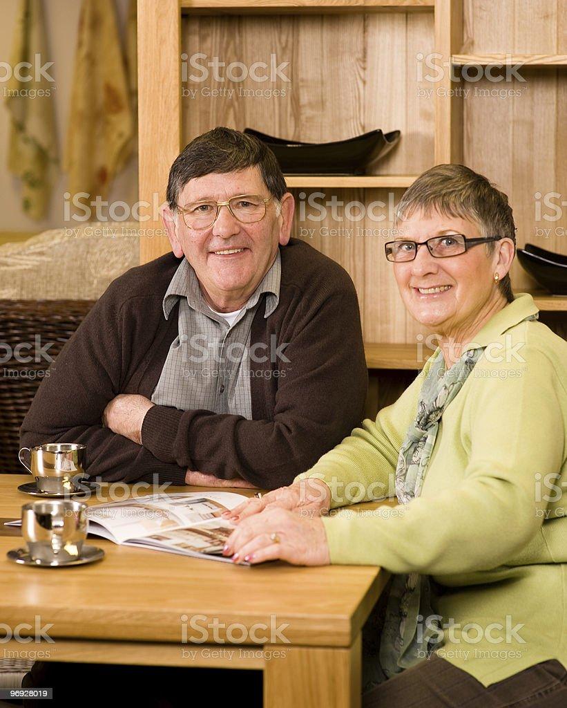 Senior man and woman couple looking at brochure royalty-free stock photo