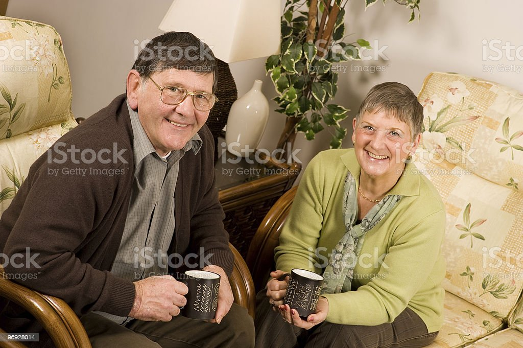 Senior man and woman couple relaxing royalty-free stock photo