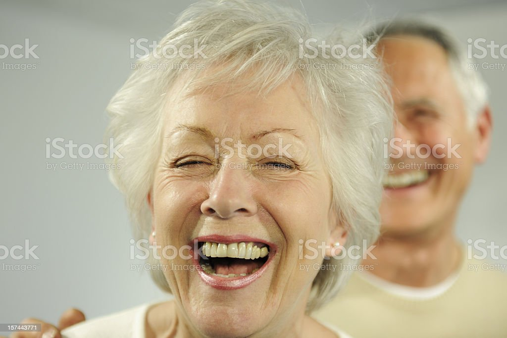 A senior man and woman laughing hysterically. royalty-free stock photo