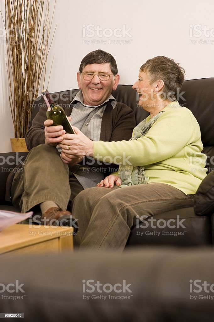 Senior man and woman relaxing with wine royalty-free stock photo