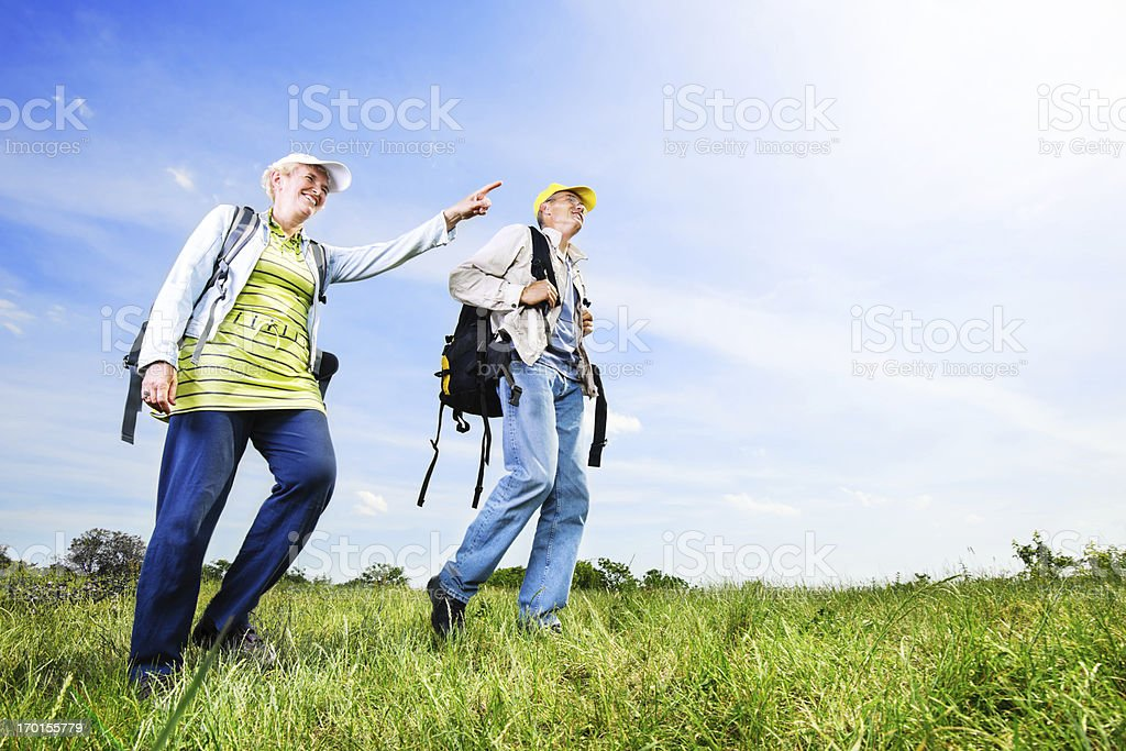 Senior man and woman tourists enjoying in the park royalty-free stock photo