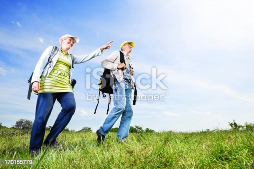 istock Senior man and woman tourists enjoying in the park 170155779