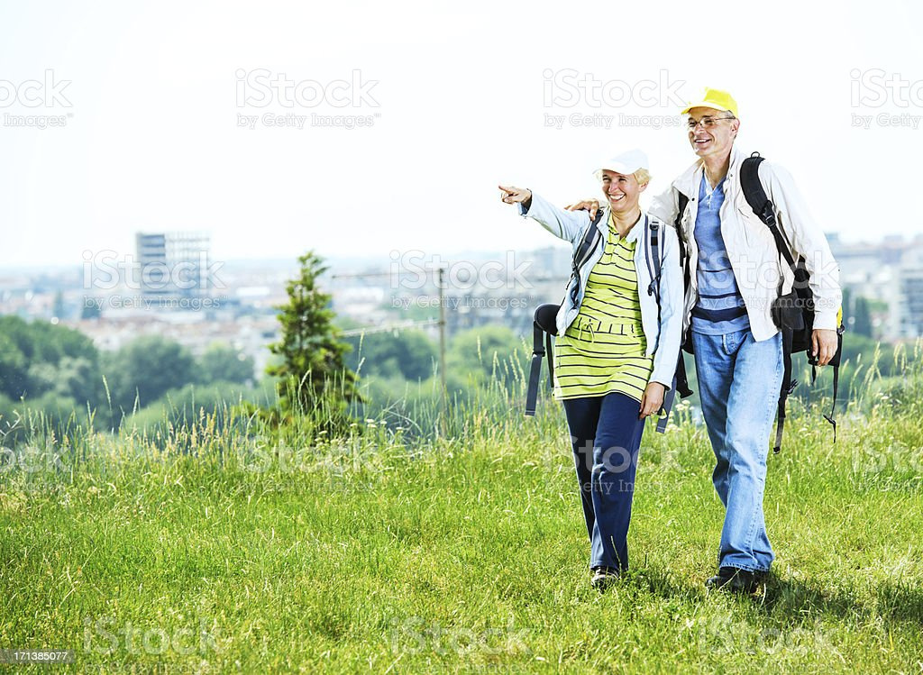 Senior man and woman tourists enjoying in the park. stock photo