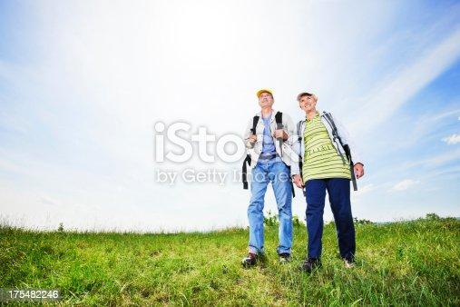 119998253istockphoto Senior man and woman tourists walking. 175482246