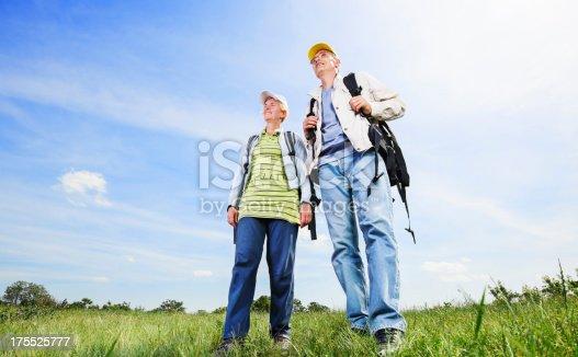 119998253istockphoto Senior man and woman tourists walking 175525777