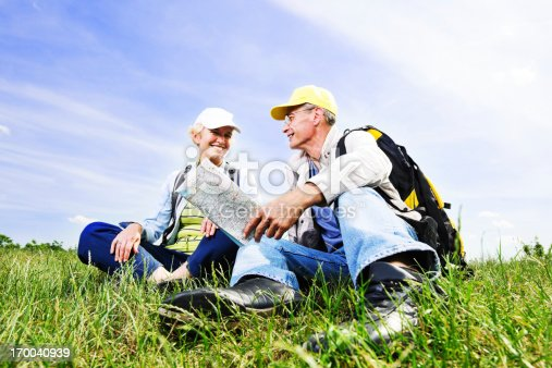 119998253istockphoto Senior man and woman tourists with a map 170040939