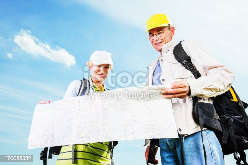 119998253istockphoto Senior man and woman tourists with a map. 170088632