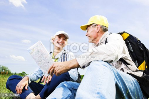 istock Senior man and woman tourists with a map. 170162302