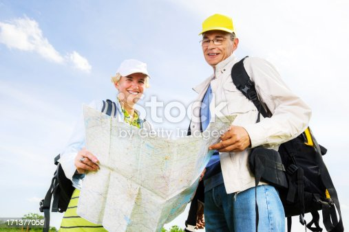 119998253istockphoto Senior man and woman tourists with a map. 171377058