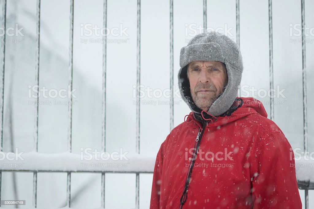 Senior Man at Camp Fence, Snowing, Julian Alps, Europe stock photo