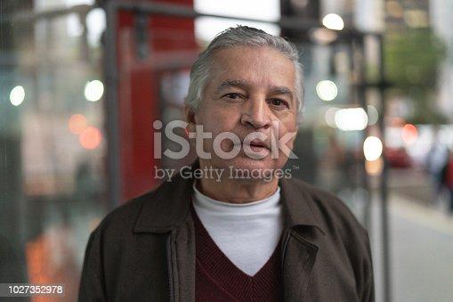 istock Senior Man at city night 1027352978