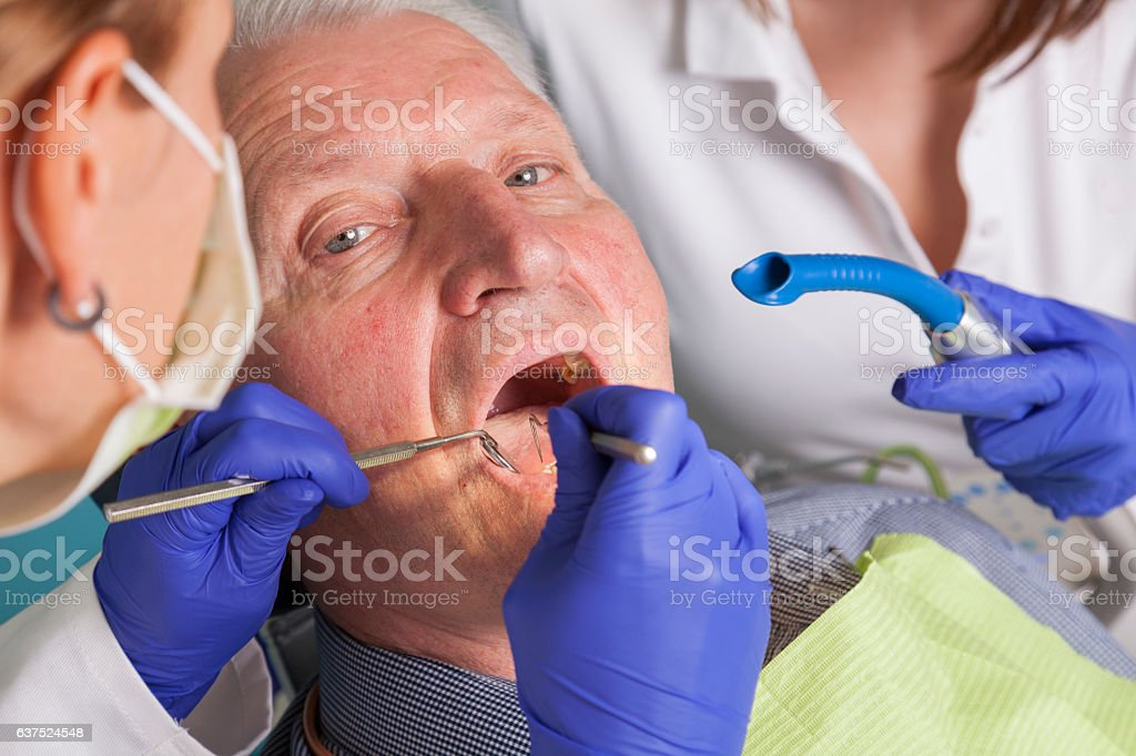 senior man at dental treatment - foto de stock