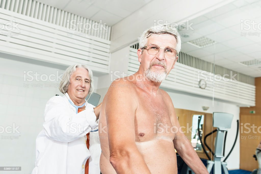 Senior man at fitness stock photo