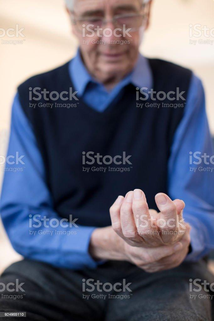 Senior Man At Home Suffering With Arthritis stock photo