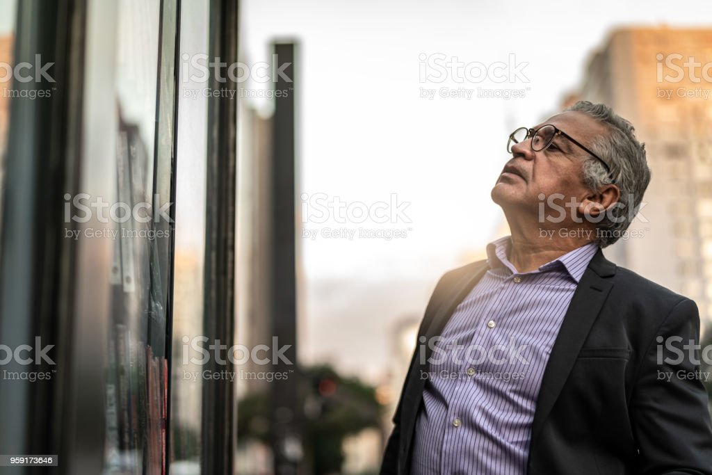 Senior Man at looking for Store WindowLooking Through Window, stock photo