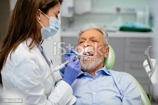 Senior man at the dentist. Shadow DOF. Developed from RAW; retouched with special care and attention; Small amount of grain added for best final impression. 16 bit Adobe RGB color profile.