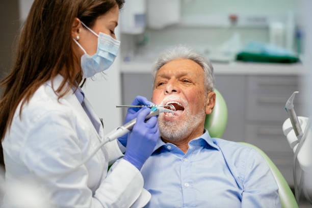 senior man at the dentist - dentista foto e immagini stock