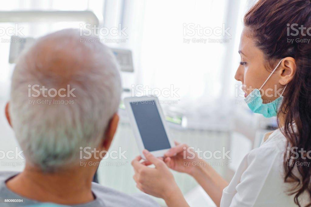Senior man at the dentist stock photo