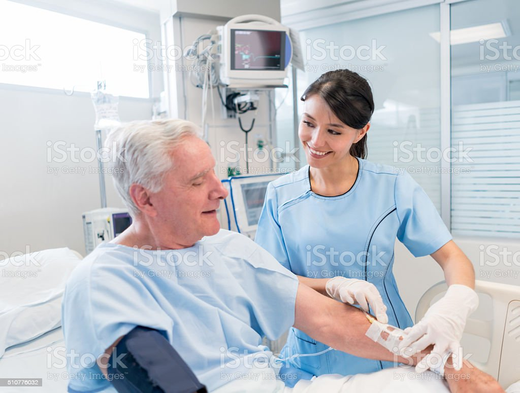 Senior man at the ICU stock photo