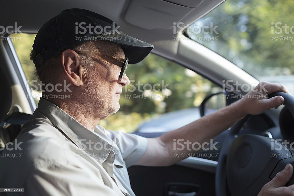 Senior man at the wheel stock photo