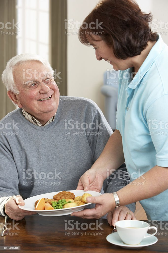 Senior Man Being Served Meal By Carer royalty-free stock photo