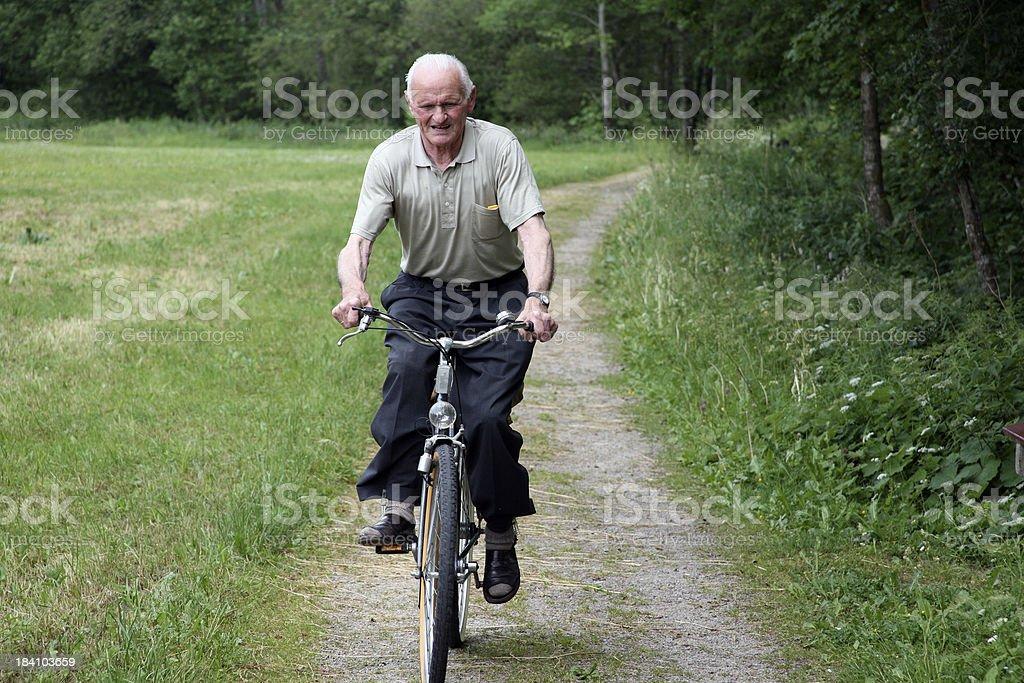 Senior man biking royalty-free stock photo